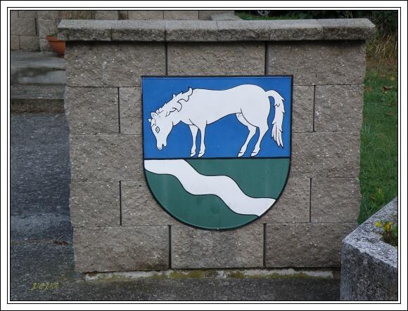 Kůň pijící z potoka, znak města Hranice