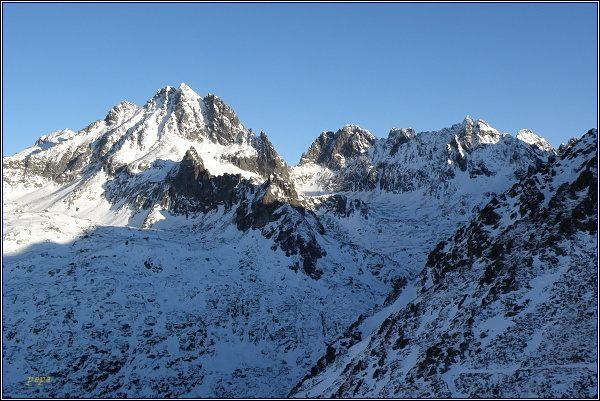 Rumanova dolina od Končistej. Vlevo Koruna Vysokej. V levé části horizontu (zleva) Ganek, Rumanovštít , Zlobivá a Západný Železný štít