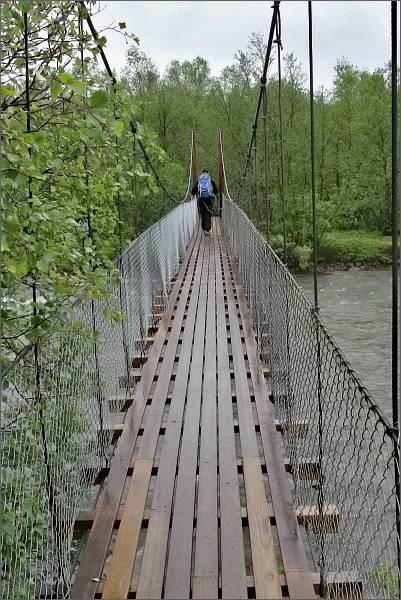 Národní park Stabbursdalen, visutý most přes řeku Stabburselva